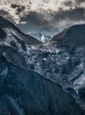 Jaroslaw Blaminsky CLOUDY SUNLIT MOUNTAINS Rocks/Mountains