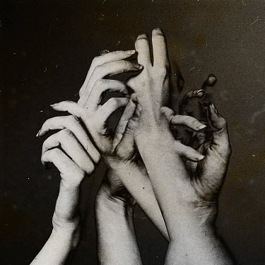 Oana Stoian CLOSE UP OF SURREAL CLUTCHING HANDS Groups/Crowds