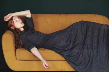 Natalia Ciobanu WOMAN WITH RED HAIR DAYDREAMING ON SOFA Women