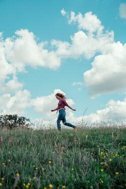 Rekha Garton WOMAN RUNNING IN SUMMERY COUNTRYSIDE Women