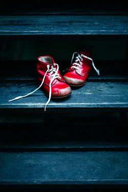 Magdalena Russocka child's red shoes left on wooden steps