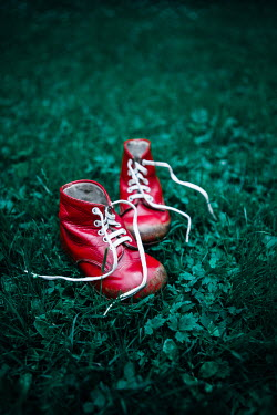 Magdalena Russocka child's red shoes lying on grass