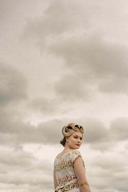Shelley Richmond RETRO BLONDE WOMAN IN FLORAL DRESS Women