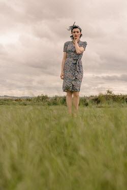 Shelley Richmond RETRO WOMAN STANDING IN FIELD Women