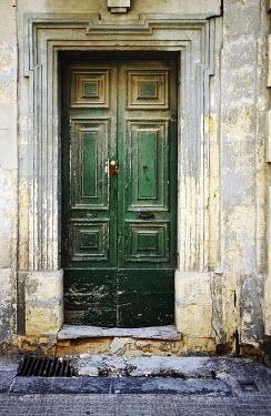 Irene Lamprakou Green rustic doors outside Building Detail