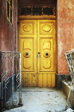 Irene Lamprakou Yellow rustic door with railings Building Detail