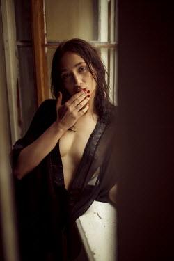 Ihor Ustynskyi SEXY WOMAN IN NIGHTDRESS LOOKING AT CAMERA Women