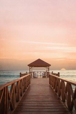 Joanna Czogala wooden jetty at sunset Seascapes/Beaches