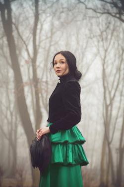 Joanna Czogala Retro woman stood in forest Women