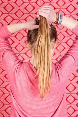 Jean Ladzinski Girl tying hair up Women