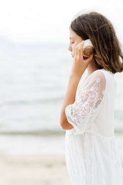 Krasimira Petrova Shishkova Girl listening to seashell Children