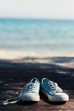 Krasimira Petrova Shishkova blue sneakers left on beach Miscellaneous Objects