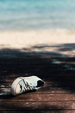 Krasimira Petrova Shishkova blue sneakers left on wooden floor Miscellaneous Objects