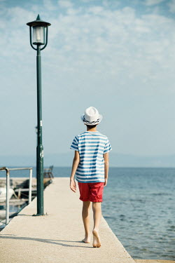 Krasimira Petrova Shishkova boy walking on jetty by the sea Children