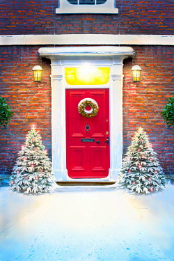 Lee Avison front door of a house at christmas with decorations and snow