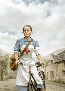 Stephen Mulcahey A wartime nurse  riding through a village Women