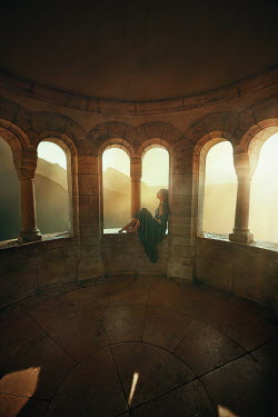 Terrence Drysdale WOMAN SITTING BETWEEN SUNLIT ARCHES Women
