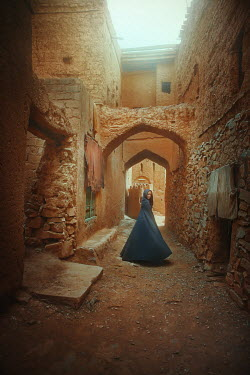 Terrence Drysdale WOMAN IN ROBES STANDING IN CRUMBLING PASSAGEWAY Women