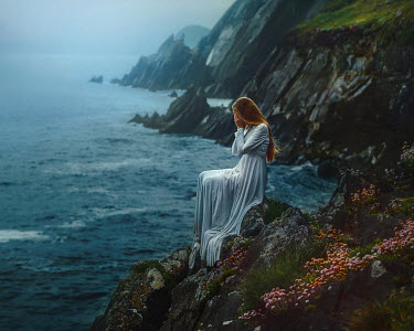 Terrence Drysdale WOMAN SITTING ON A CLIFF BY THE SEA CRYING Women