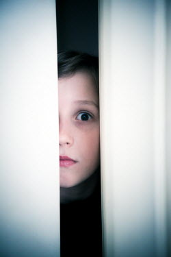 Katya Evdokimova SURPRISED BOY LOOKING THROUGH GAP IN DOOR Children