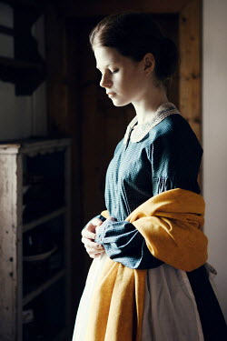 Magdalena Russocka historical woman in kitchen