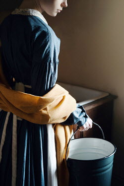 Magdalena Russocka historical woman holding bucket inside