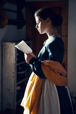 Magdalena Russocka historical woman reading letter inside
