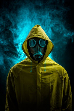 Magdalena Russocka man in gas mask wearing yellow raincoat in smoke