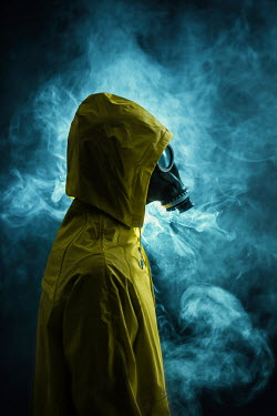 Magdalena Russocka MAN IN GAS MASK AND PLASTIC COAT WITH SMOKE Men