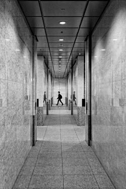 Eric Forey BOY WALKING IN CORRIDOR OF MODERN INTERIOR Men
