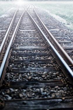 Ysbrand Cosijn CLOSE UP OF MISTY RURAL RAILWAY TRACKS Railways/Trains