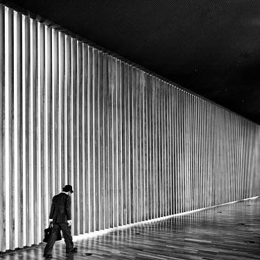 Eric Forey BUSINESSMAN WALKING IN MODERN BUILDING Men