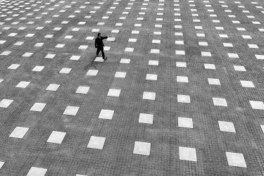 Eric Forey MAN WALKING ON CHECKERED FLAGSTONES Men
