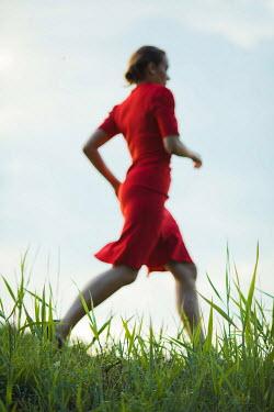 Ildiko Neer Vintage woman running in grass