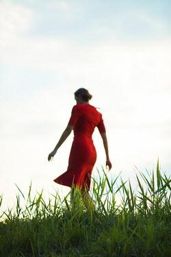 Ildiko Neer Vintage woman dancing in grass