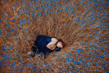Nathalie Seiferth WOMAN SLEEPING IN BLUE FLOWERS FROM ABOVE Women