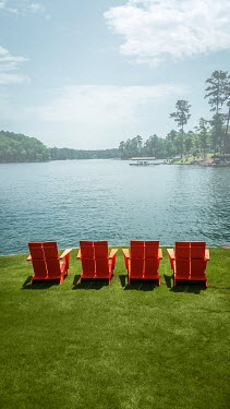 Stephen Carroll Red chairs by lake