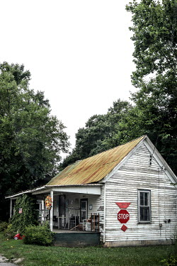 Stephen Carroll Weathered house with stop sign
