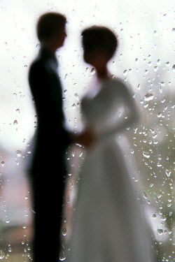 Ute Klaphake Blurred wedding couple by rainy window