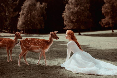 Nathalie Seiferth Young woman with deer in field