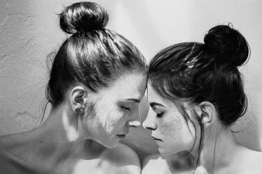 Nathalie Seiferth Two young women touching noses
