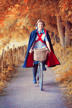 Lee Avison 1940s nurse riding a bicycle on an autumn lane Women