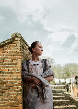 Stephen Mulcahey SAD HISTORICAL MAID LEANING BY WALL Women