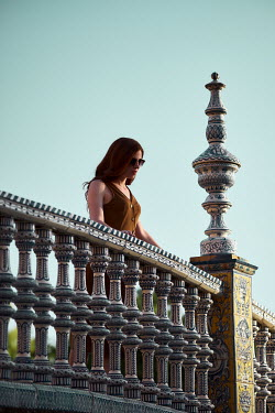 Chris Reeve Woman stood on ornate balcony Women