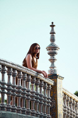 Chris Reeve Women stood over ornate balcony Women