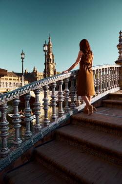 Chris Reeve Woman standing on bridge in city Women