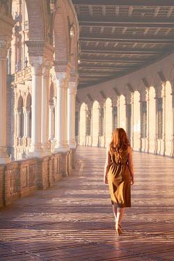 Chris Reeve Woman walking through ornate building Women