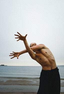 Daniil Kontorovich Man dancing on beach Men