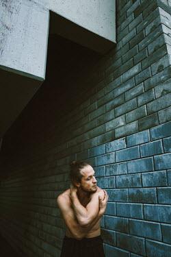 Daniil Kontorovich Man stretching by a wall Men