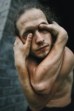 Daniil Kontorovich Man pressing his eyes Men